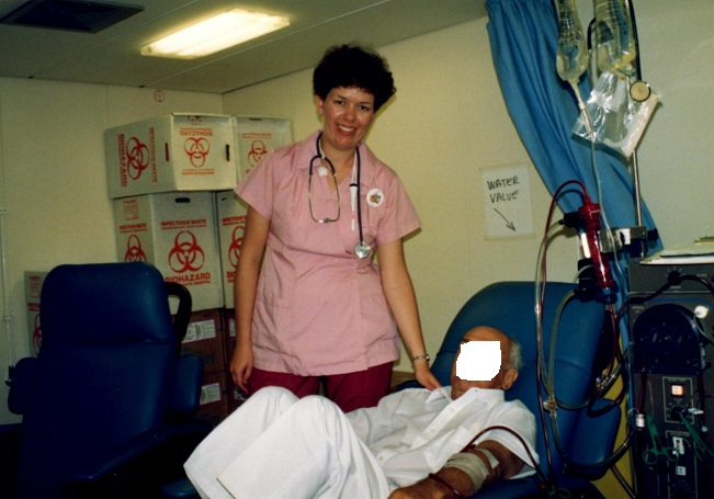 Pam with one of her patients using the old dialysis machine