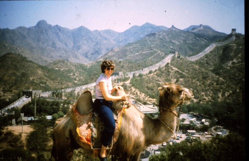 Pam sits on a camel at the Great Wall! 1986
