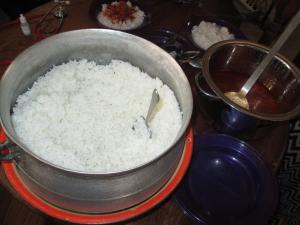 Pot of rice for lunch with tasty sauce!