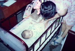 Mrs. Li tends her new baby boy.