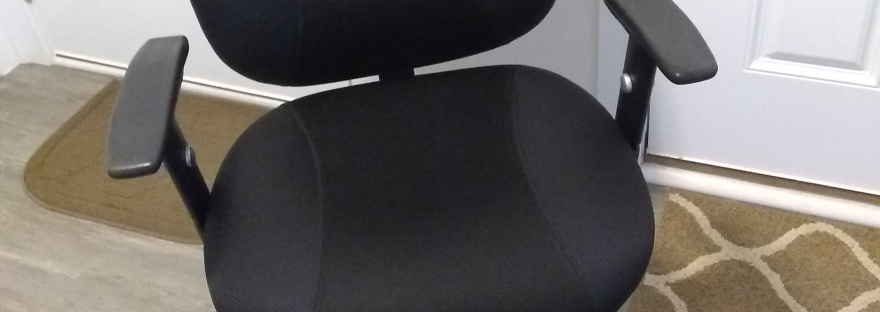 Phot of black office chair with wheels.